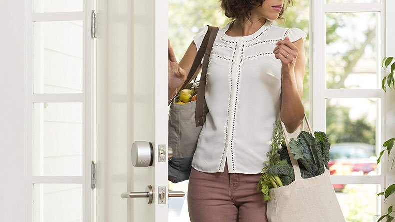 Woman entering house with smart lock